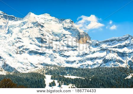Beautiful Alps Mountain with the hidden face at the edge of the mountain at Jungfrau Switzerland.