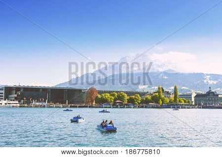 Lucerne Switzerland - April 29 2017: Beautiful lake Lucerne and pedal boat at Lucerne Switzerland with a beautiful mountain in the background.