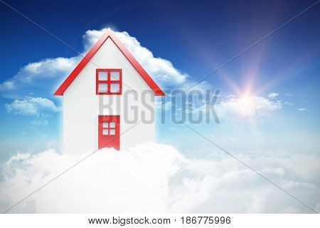 Composite image of 3d house against bright blue sky with clouds