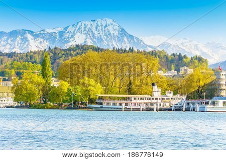 Lucerne Switzerland - April 29 2017: Beautiful lake Lucerne with the boat in bright day and beautiful mountain in a background.