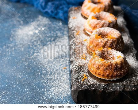 Bundt Cakes On Dark Background And Serving Board