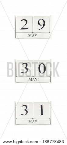Closeup group of white wooden calendar with black 29 may 30 may 31 may word three date calendar isolated on white background