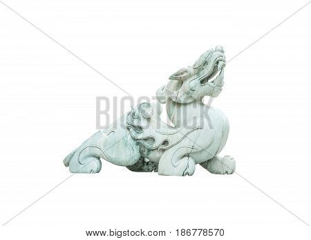 Closeup old green jade leo statue for good fortune in front of door in the temple of thailand isolated on white background with clipping path