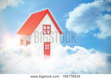 Digital composite of 3d house in blue sky