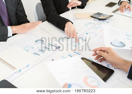 Business people discussing documents at the meeting - brainstorming concept