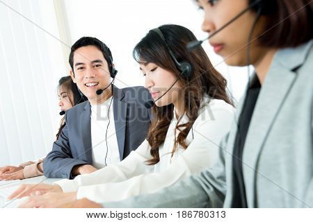 Call center ( telemarketer or operator) team - customer service and support concept
