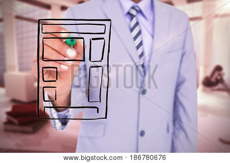 Midsection of businessman writing with marker against computer generated image of workplace