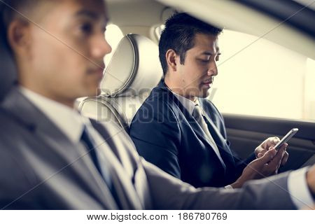 Businessman Use Mobile Inside Car