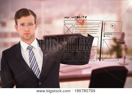 Geeky businessman writing with marker against composite image of workplace