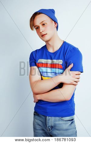 young handsome teenage hipster guy posing emotional, happy smiling against white background isolated, lifestyle people concept close up