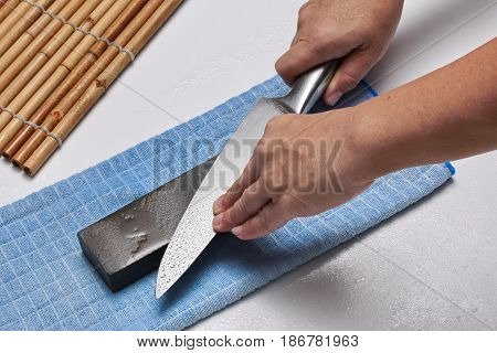 Handle The Knife To Make A Sharp Knife With A Whetstone.