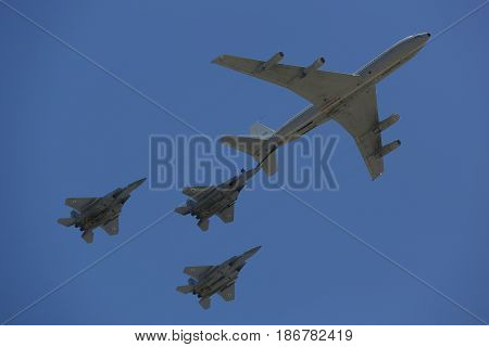 BEER SHEBA, ISRAEL - MAY 2, 2017: Boeing 707 refueling tanker in formation with F-15I all-weather multi role strike fighter during Israel's Annual Independence Day Air Force Flyover in Beer Sheba