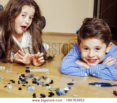 funny cute children playing at home, boys and girl smiling, first education role close up, lifestyle people concept