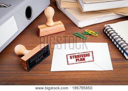 Strategic Plan. Rubber Stamp on desk in the Office.