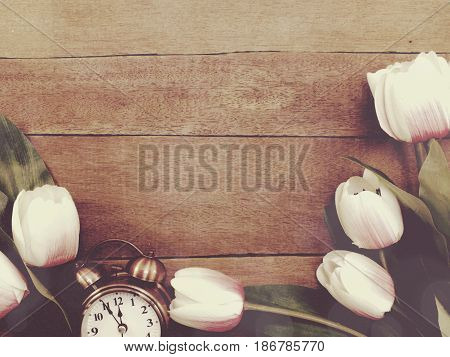 Alarm Clock With Beautiful Bouquet Of Tulips On Wooden Background
