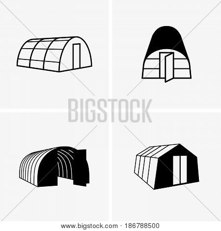 Set of four greenhouses on grey background
