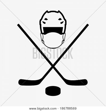 Two sticks, a mask and a puck for hockey