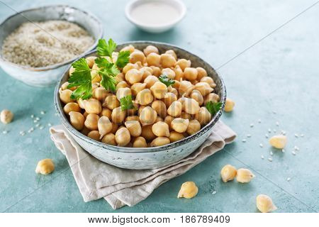 Ingredients for cooking hummus. Chickpeas sesame seeds and oil