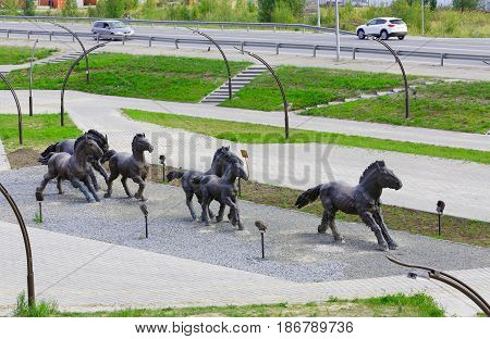Editorial.Khanty-Mansiysk, Yugra, Russia, August 12, 2012 . Archeopark. Samarovo town The sculptural composition A herd of wild horses