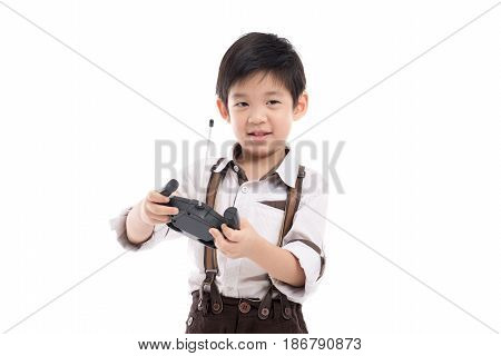 Asian child holding radio remote control on white background isolated