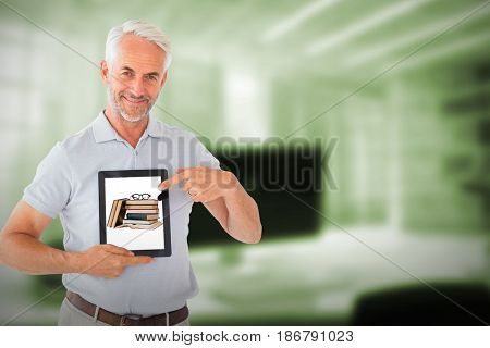 Mature student showing tablet pc against digital image of workplace