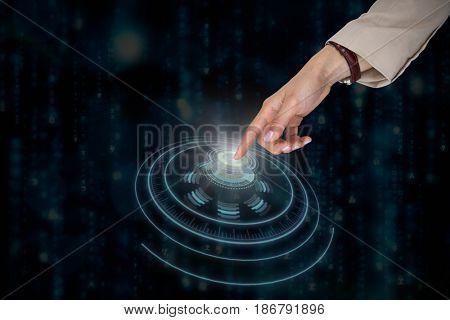 Businesswoman using imaginative digital screen against digitally generated black and blue matrix