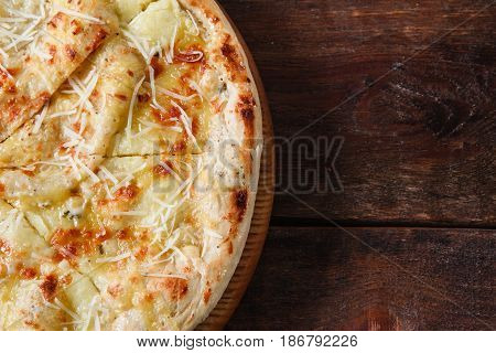 Junk food, bad habits, unhealthy eating, calories. Fresh hot cheese pizza served on rustic wooden table, flat lay with free space for text.