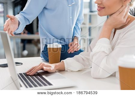 Cropped Shot Of Young Businesswomen Working With Laptop And Talking In Small Business Office