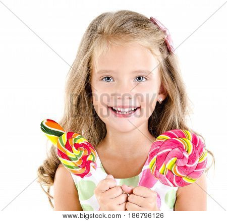 Happy little girl with lollipops isolated on a white