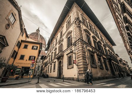 FLORENCE, ITALY. January 08, 2017: Historic center of Florence, Italy. Corner of the Servi and Via dei Pucci. In the background the cathedral of Santa Maria del Fiore.