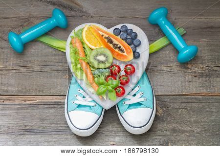 Healthy lifestyle concept with diet and fitness abstract on wooden boards