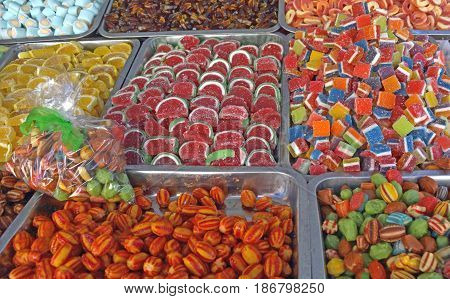 Beautiful colorful of sweet and in various forms silken sweets exposed for sale.