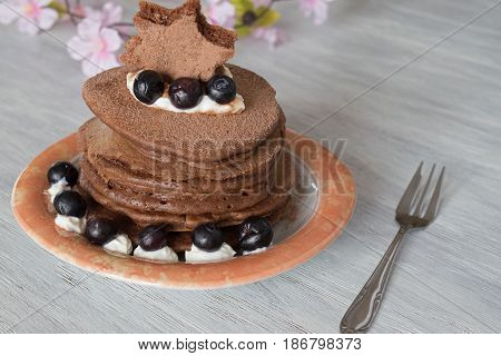 Stack of Delicious Chocolate Pancakes with Blueberries jn table