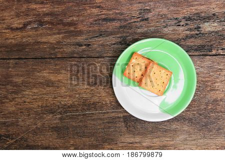 cookies bread square in the plate on old wooden floor background
