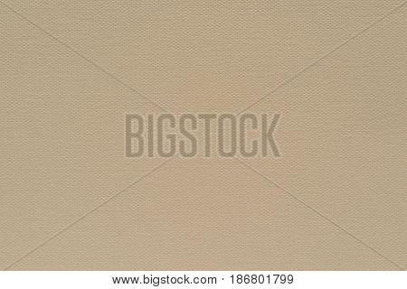 abstract grained texture of speckled fabric or paper material of pale beige color