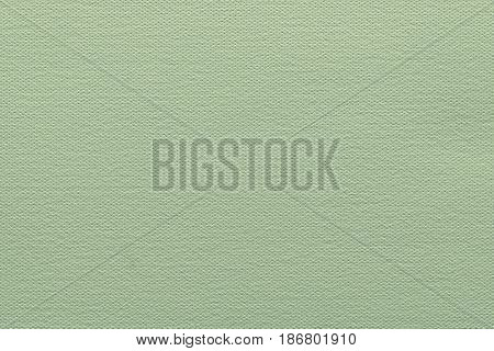 abstract grained texture of speckled fabric or paper material of pale green color