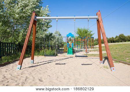 Double Empty Swings In Park Of Madrid