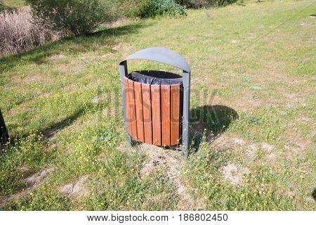 High View Of Wooden Garbage Bin In Park