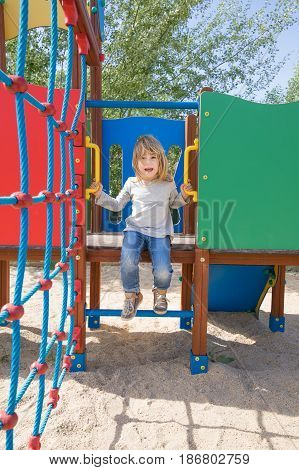 Kid Talking Climbed On Slide In Playground