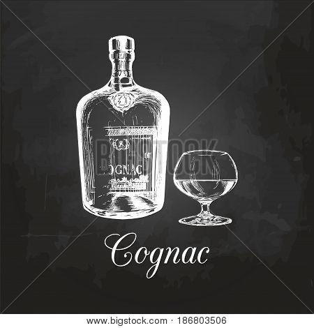 Hand sketched cognac bottle and glass. Vector illustration of brandy set on a chalkboard. Vintage alcoholic drink menu design concept for bar, restaurant etc.