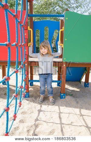Smiling Kid Hanging In Playground