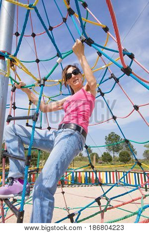Woman Climbing In Rope Ladder