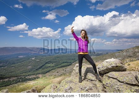 Woman On Top Of Mountain Photographing Selfie
