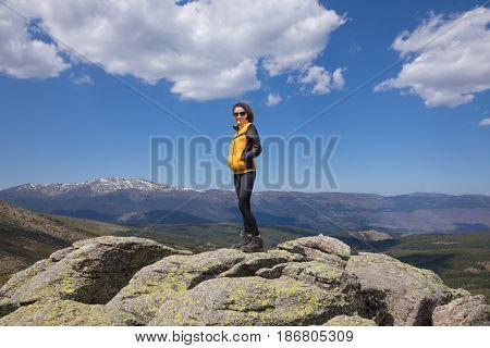 Woman Posing On Rock Peak In Guadarrama