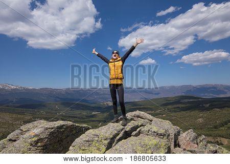 Woman Screaming On Top Of Mountain