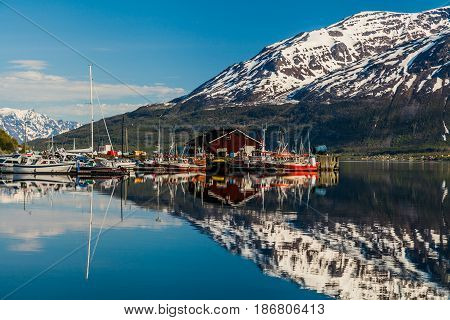 Beautiful fjord with snowy mountains in Norway.