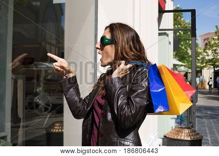 Woman With Shopping Bags Loves A Store