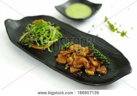Sauteed Beef With Green Pepper And Chili Sauce, Salald On Black Platter