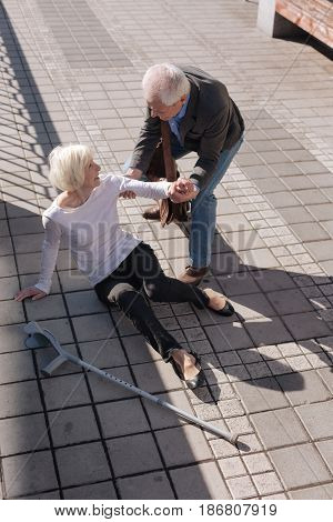 We must not despond. Beautiful old nasty woman turning her ankle and falling down while amiable man trying to help her