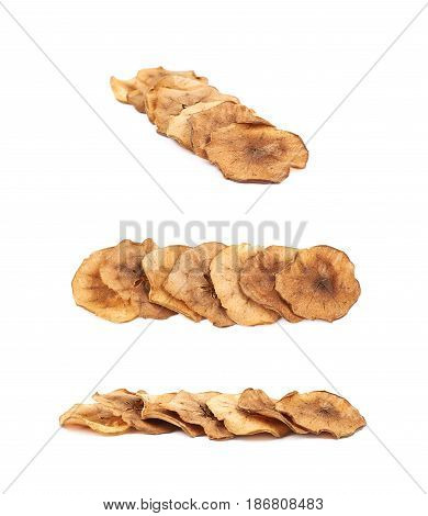 Pile of dried slices of apple chips coated with cinnamon, composition isolated over the white background, set of three different foreshortenings